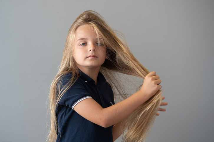 https://iheartintelligence.com/wp-content/uploads/2020/08/boy-9-donates-his-2ft-locks-to-be-made-into-wigs-for-children-with-cancer2.jpg